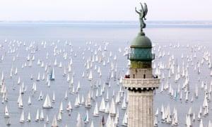 Faro della Vittoria lighthouse, sailing boats taking part in the historic sailing regatta Barcolana