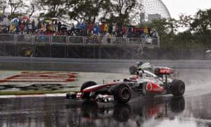 Jenson Button races in the rain
