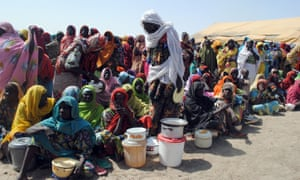 Internally displaced people wait for food at Dikwa camp, in Borno state, north-eastern Nigeria.