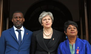 Theresa May with Stuart and Doreen Lawrence outside the memorial service.