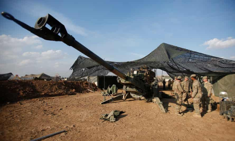US soldiers from the 2nd Brigade, 82nd Airborne Division gather around an artillery at a military base north of Mosul, Iraq, on 14 February.