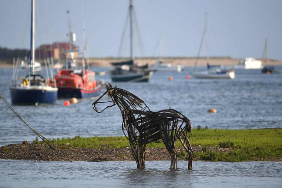 """The Lifeboat Horse"""" sculpture by Rachael Long stands on the mud flats at Wells-next-the-Sea in Norfolk."""