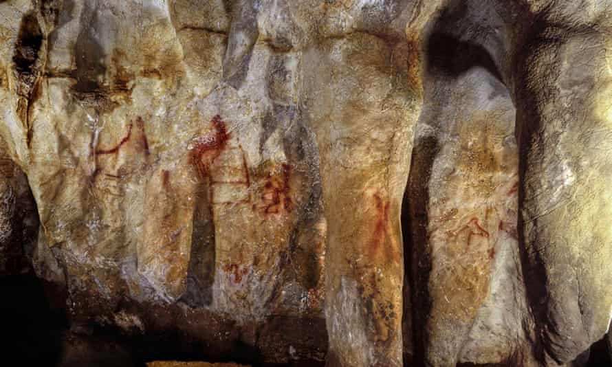 Paintings on a section of the La Pasiega cave wall, including a ladder shape composed of red horizontal and vertical lines.