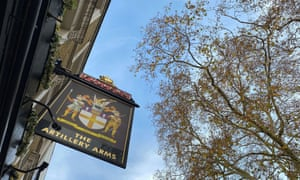 Sign hangs outside The Artillery Arms pub, owned by Fuller's and temporarily closed amid the coronavirus disease (COVID-19) outbreak in London.