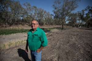 Local man Keith Burke standing in the empty Namoi river