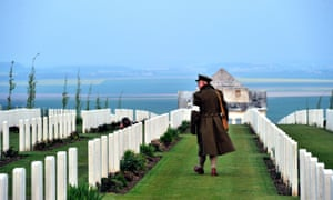 An Australian wearing an WWI uniform, walks past graves at the Australian War Memorial in the northern French city of Villers-Bretonneux.