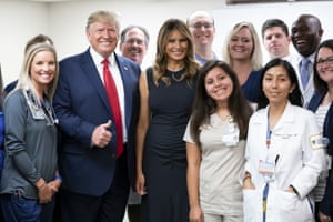 Donald and Melania Trump pose with emergency first responders at Miami Valley Hospital in Dayton.