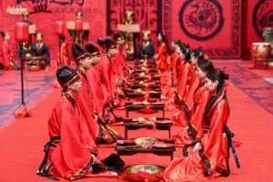 Couples take part in a group wedding ceremony in traditional Han dynasty style as they celebrate the Qixi festival, or Chinese Valentine's Day, Hengyang, Hunan province, China