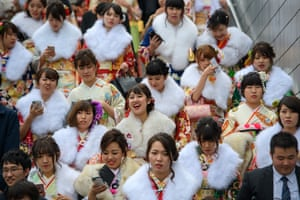 A crowd of women leave the ceremony, which is held on the second Monday in January.