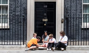Jess Phillips joins her son Danny (in orange) and other children on the Downing Street step for a homework session