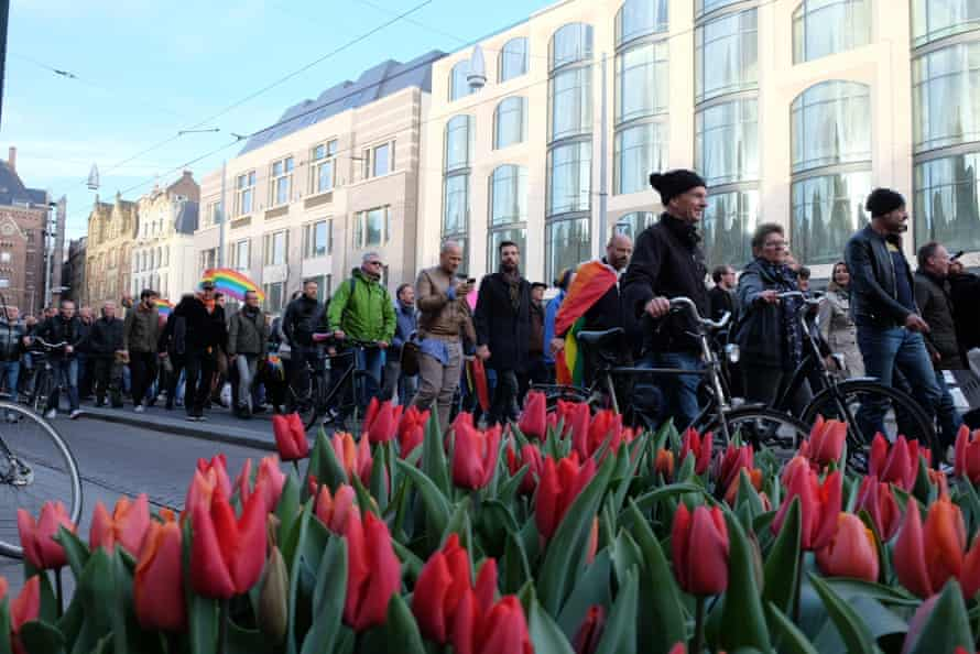 Protesters march through Amsterdam on Wednesday.