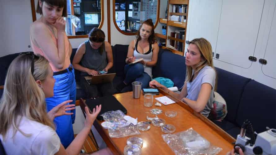 Emily Penn, far left, talks with the eXXpedition crew members Elise Chappell, Becca Finlayson, Meg Tapp, and Sarah Michler.