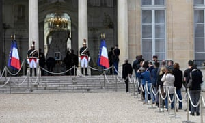 People line up outside the Élysée Palace in Paris to pay tribute to the former French president Jacques Chirac