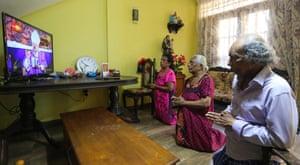 A Sri Lankan Catholic family observe Sunday mass at home