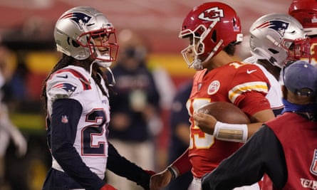 Stephon Gilmore, left, talks with Kansas City Chiefs quarterback Patrick Mahomes after their Monday night NFL meeting