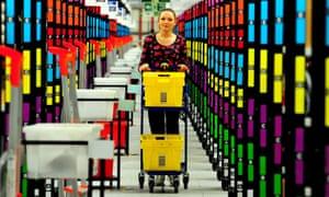 A member of staff filling an order at an Amazon fulfillment centre in Hemel Hempstead, Hertfordshire.