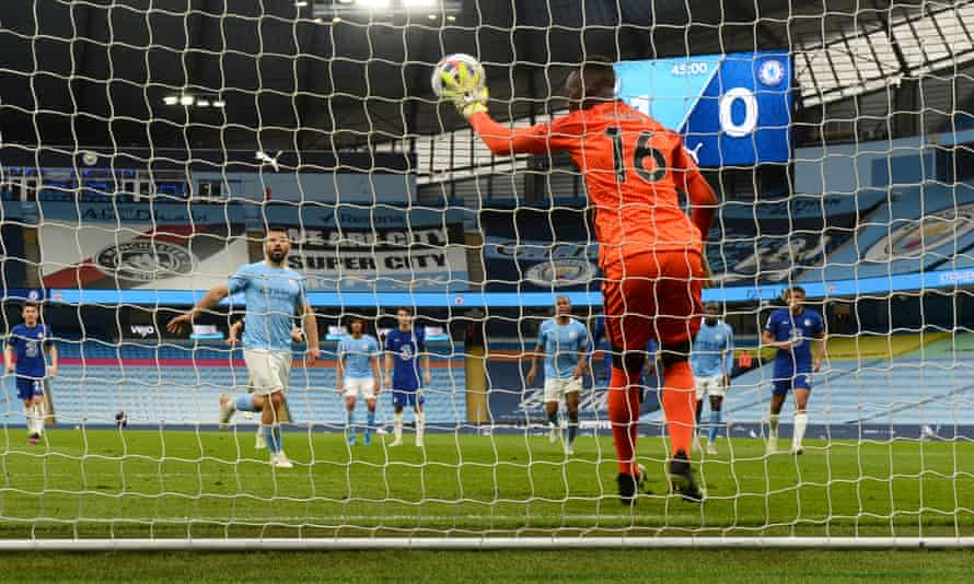 Sergio Agüero watches his tame penalty sail harmlessly into Édouard Mendy's grasp.