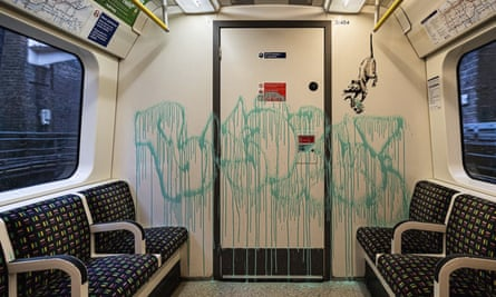 Some of Banksy's work inside a London Underground tube carriage.