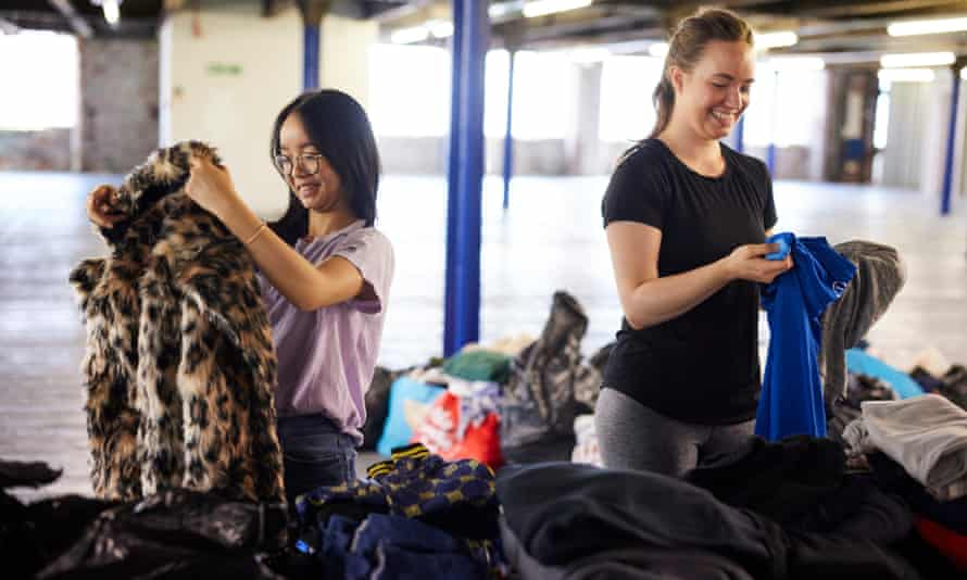 Volunteers from the Care4Calais charity sort through donations at a warehouse in Stockport, Greater Manchester