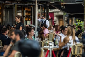 A waiter takes an order as bars and restaurants reopen in Paris
