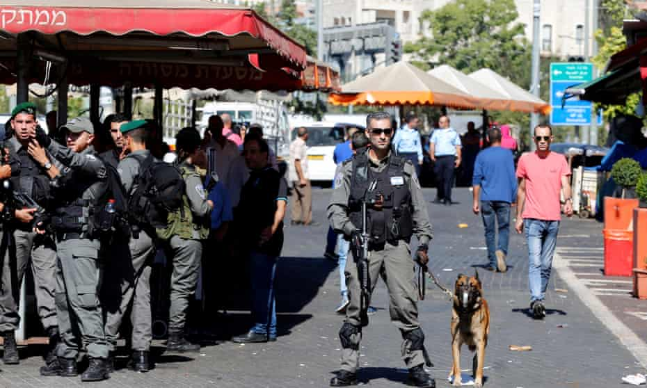 Israeli border police secure the area following the attack outside Herod's Gate.