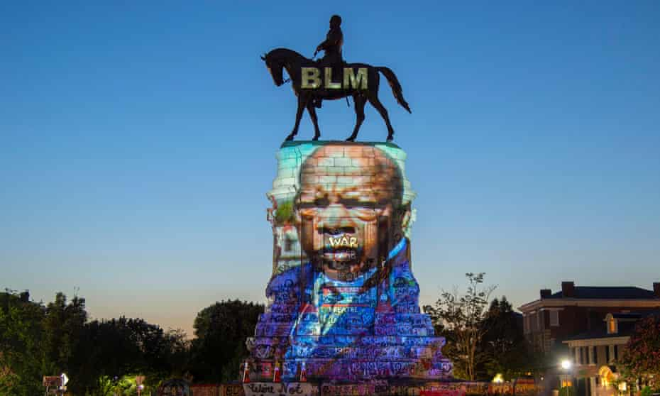 The image of the late congressman John Lewis is projected on the statue of the Confederate general Robert E Lee in Richmond, Virginia, in July 2020.