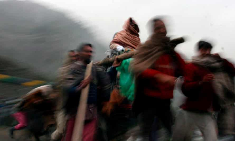 A woman is carried to a shrine in Indian Kashmir.