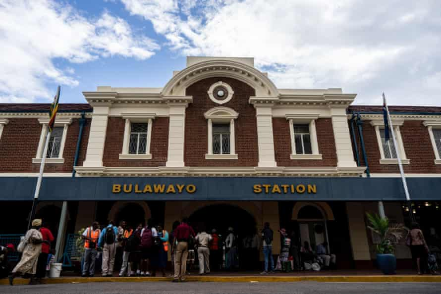 Passengers buy tickets for the train to Cowdray Park