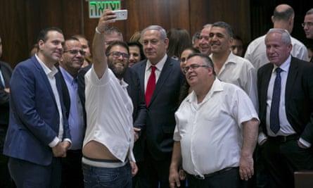 Benjamin Netanyahu and members of his party take a selfie in Israel's parliament