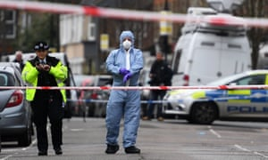 Police at the scene of a shooting in north London