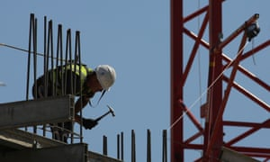 A construction worker works on a construction site in London