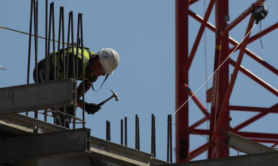 Worker hammering on construction site