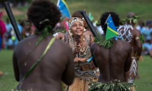 Traditional dancers perform for the Prince of Wales in Honiara at the end of a three-day royal visit to the Solomon Islands.