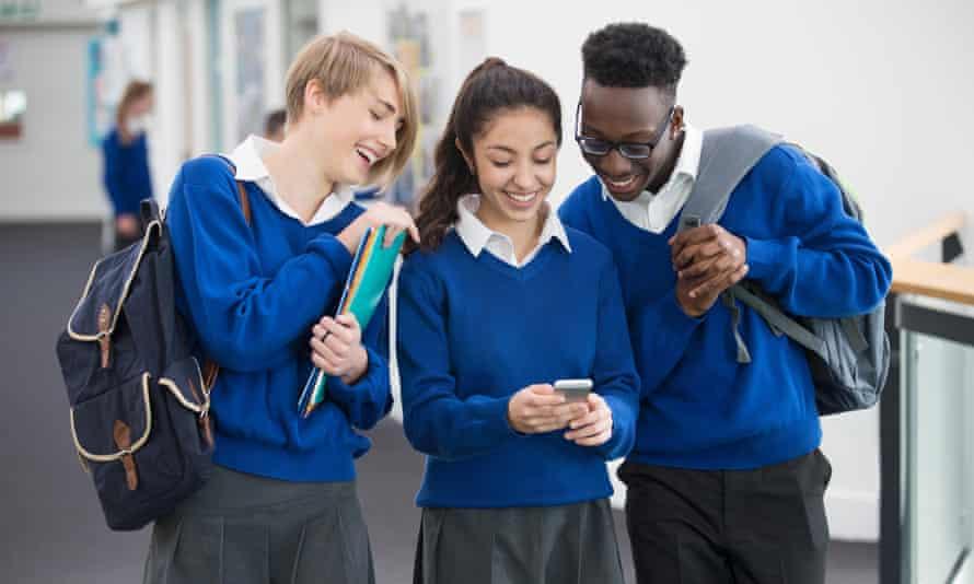 school kids looking at phone