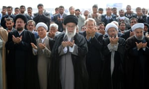 Iranian supreme leader Ayatollah Ali Khamenei (centre) leading the Eid al-Fitr prayers with former president Hashemi Rafsanjani on his right.