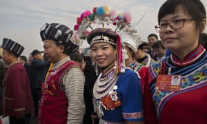 Delegates representing ethnic minorities arrive at the Great Hall of the People for the opening session of the National People's Congress on Monday