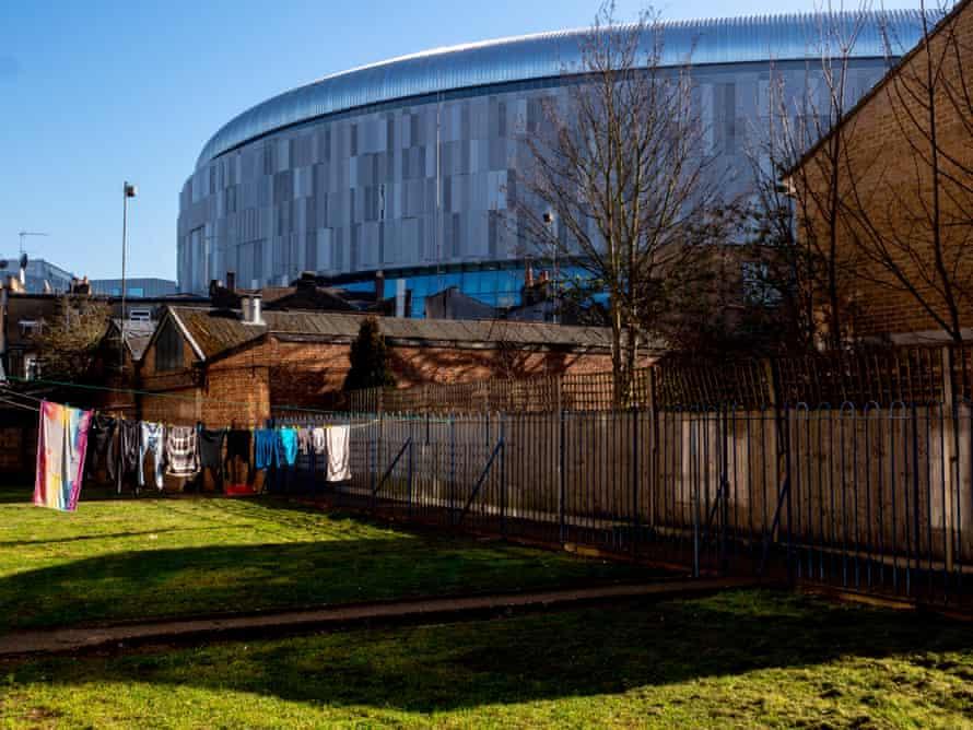 The new Tottenham Hotspur stadium is seen behind local housing.