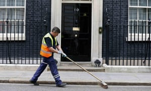 Man sweeps street outside No 10 Downing Street