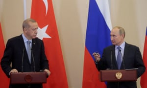 President Recep Tayyip Erdoğan of Turkey, left, with the Russian president, Vladimir Putin, at a joint news conference following talks in Sochi, Russia, in October