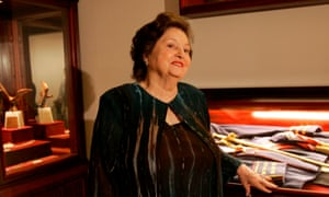 Lucia Hiriart, widow of Chile's late dictator Augusto Pinochet, next to a show case containing a uniform that belonged to her husband.
