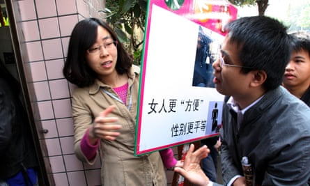 A Chinese student occupies a men's toilet to protest for more cubicles for women, 2012.