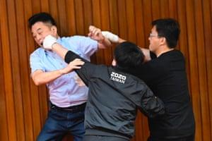 A KMT legislator fights with a DPP lawmaker