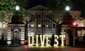 The word divest is spelt out in lights in the street outside the Irish Parliament