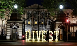 A message to the Irish government to divest from fossil fuels is spelled out in lights in front of the lower house of parliament.