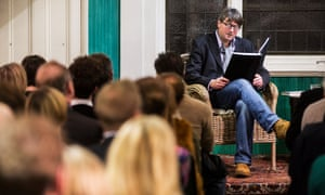 Poet laureate Simon Armitage reads to an audience