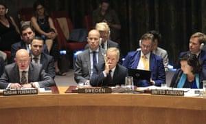 The UK ambassador, Karen Pierce, listens to Russia's ambassador, Vasily Nebenzya at a UN security council meeting.