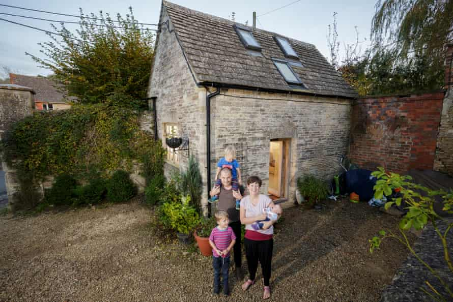 Tim Francis and his wife, Laura Hubbard-Miles, and their children – baby Edith, Tom, three, and James, five – outside their tiny home, the Fruit Store, in Gloucestershire.