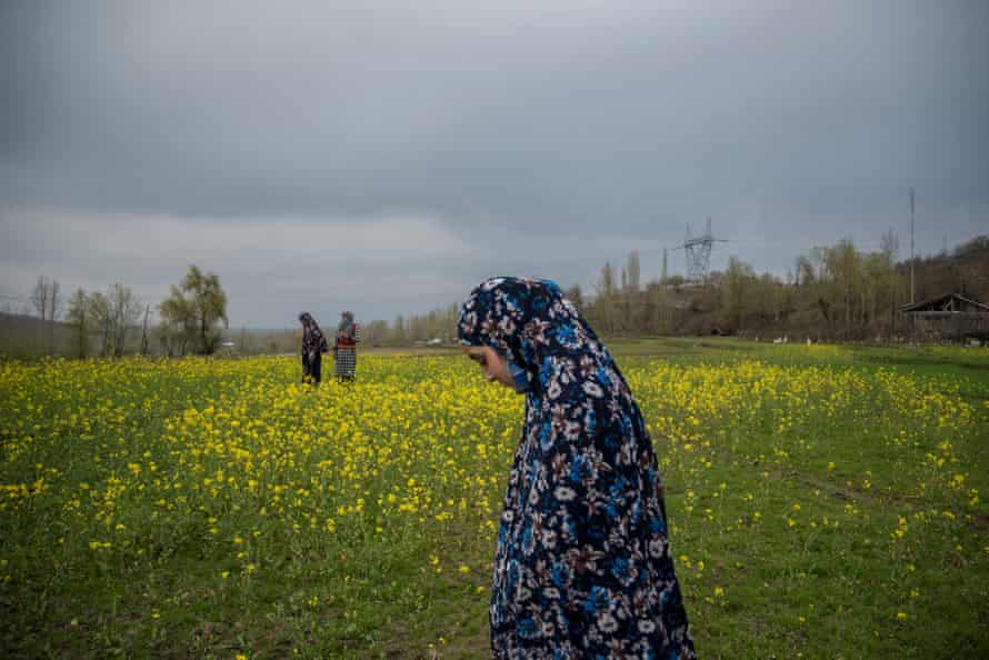 Mubashira walks through a mustard field near her house with her friends from the group. Since they started going to school, some girls also meet at their friends' homes after school to do homework, discuss their studies and have fun. 2021