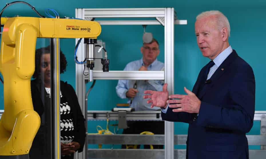 Joe Biden and a robot arm