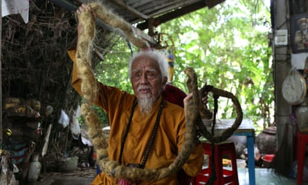 Nguyen Van Chien, 92, shows off his 5m-long hair at his home in Tien Giang province, Vietnam.